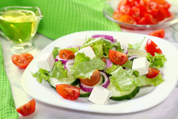 Fresh greek salad on white table