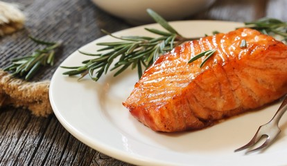 Pan fried salmon with Rosemary garnish, selective focus