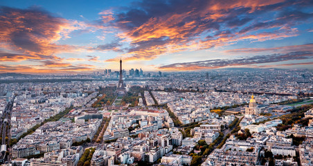 Aerial Paris panorama in late autumn from Montparnasse Tower at sunset. Eiffel Tower in the distance and financial district. Wall mural