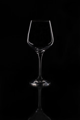 Empty wine glass. Isolated on black background