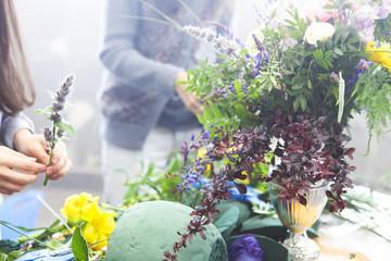 Woman decorating flower bouquet