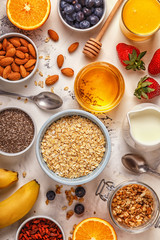 Ingredients for a healthy breakfast -  oatmeal, granola, honey,