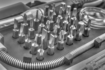 Mechanical bit tool set in black and white closeup