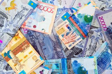 Background texture of various Kazakhstani tenge banknotes.