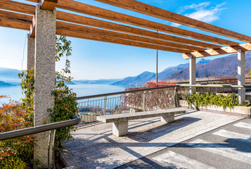 View of Lake Maggiore from the terrace with bench, Luino, province of Varese, Italy