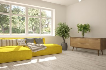 White room with yellow sofa and green landscape in window. Scandinavian interior design