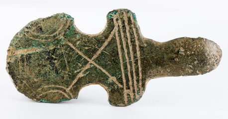 Ancient medieval adornment, possibly part of a buckle.