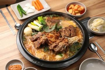 Mugeunji gamjatang. Pork Back-bone Stew with Ripe Kimchi.