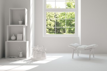 White room with chair and green landscape in window. Scandinavian interior design