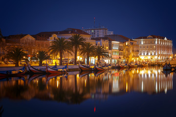 City of Aveiro canals with moliceiro tradicional boats in Portugal