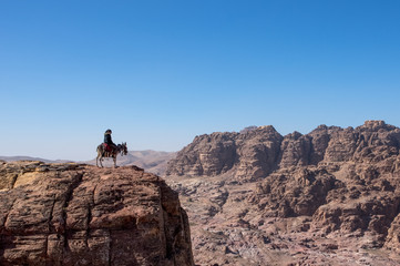 Lonely rider looking across a canyon