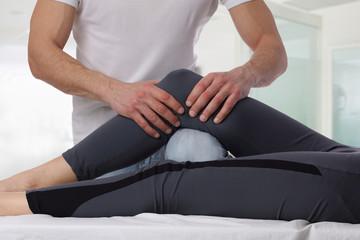 Chiropractic, osteopathy. Therapist doing healing treatment on women's leg . Alternative medicine, Physiotherapy, sport injury rehabilitation