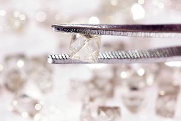 Natural  transparent diamond in tweezers