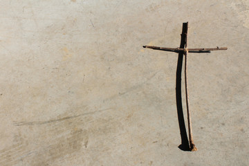 Christian cross background rough wood branches