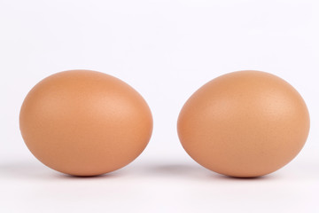 Two eggs, isolated on a white background.