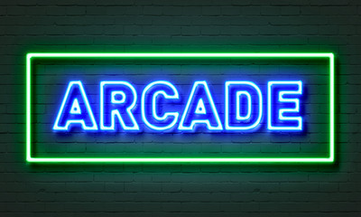 Arcade neon sign on brick wall background.