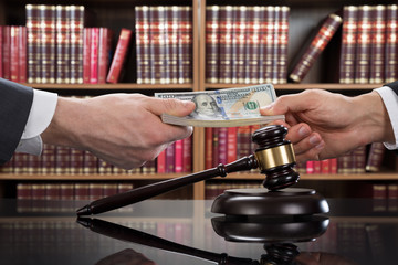 Gavel With Judge Taking Bribe From Client