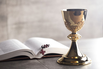 Chalice, Bible and altar cross.