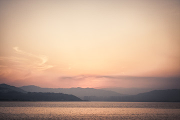 Sunset with sea and distant mountains