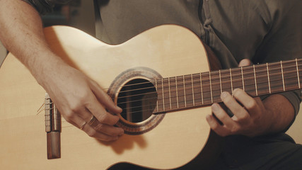 Hands of guitarist playing a guitar