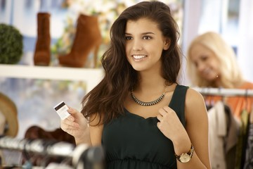 Attractive woman paying by credit card