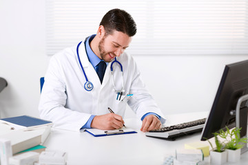 Smiling Male doctor writing notes