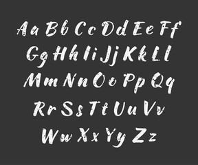 Vector handwritten brush script. alphabet. Uppercase and lowercase letters. White print on black background.