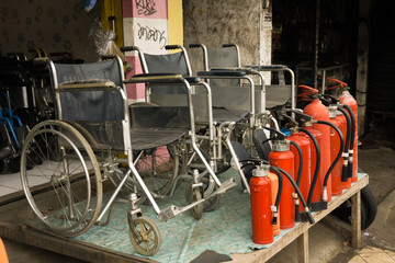 a store selling wheelchairs and fire extinguishers with red tube photo taken in Depok Indonesia