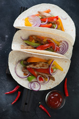 Tortillas filled with freshly made tex-mex pork fajitas