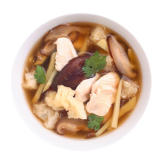 Top view of fish maw soup on white background.