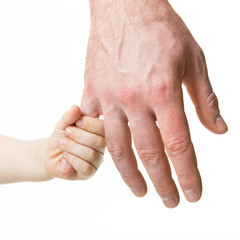 Father leads his child. Trust, family, assistance, parenting, childhood concept. Man's and kid's hands closeaup over white background.
