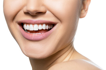 Laughing woman mouth with great teeth over white background. Healthy beautiful female smile. Teeth health, whitening, prosthetics and care.