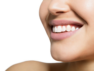 Laughing woman mouth with great teeth over white background. Healthy beautiful female smile. Teeth health and care.