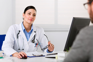 Young female doctor listening intently