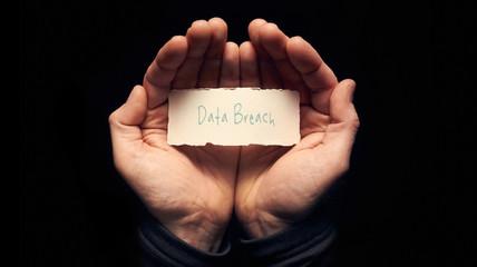Hands holding a Data Breach Concept
