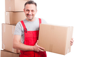 Portrait of handsome mover guy holding cardboard box