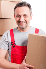 Portrait of attractive mover guy holding cardboard box
