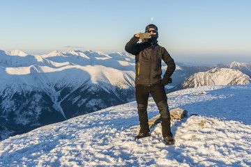 Tourist gets a selfie winter in the mountains.