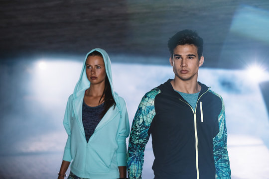 Fitness couple in city at night