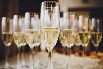 glasses of champagne on on blurred background