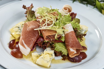 meat salad with ham cheese lettuce Dorblu grapes and olive oil