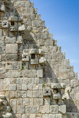detail of the large masks of the god Chaac that flank the stairs of the pyramid of the magician in the archaeological Uxmal enclosure in Yucatan, mexico