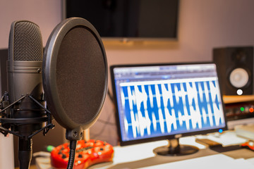 condenser microphone in digital recording, editing, broadcasting, podcast or online radio studio