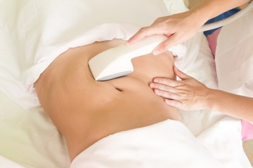 Vacuum massage of the abdomen of a young girl