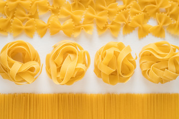 Uncooked italian pasta on a white background