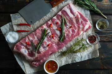 Raw pork ribs with spices and herbs