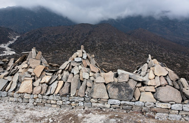 Ancient stones carved with the buddhist mantras near great stupa in Khunde - Nepal, Himalayas