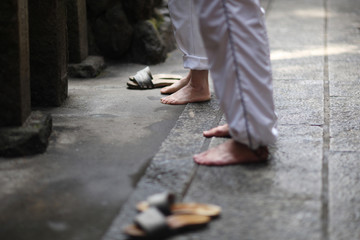 Bare feet of visitors before entering the place of worship in the temple territories