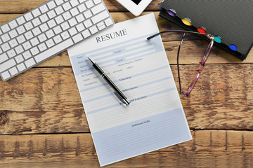 Blank resume form on wooden table
