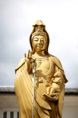Golden statue of Inari, the goddess of rice and prosperity, in Kyoto, Japan.